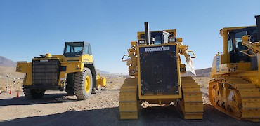 100 ton trucks and bulldozer