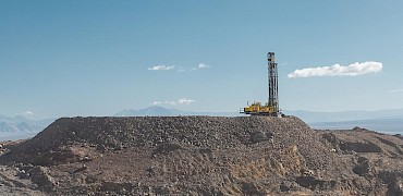 Drill rig on ore production platform
