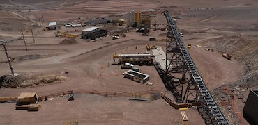Panoramic view of secondary crusher conveyor belt, stockpile, and agglomeration plant