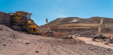 Panoramic view of the primary crusher; Lindero deposit in the background