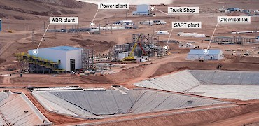 Panoramic view of leach pad solution ponds, ADR and SART plants, power plant, truck shop, and chemical lab