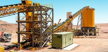 Agglomeration plant: Flake breaker and surge bin