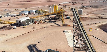 Panoramic view of stockpile, tertiary crusher, agglomeration plant and leach pad