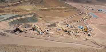 Panoramic view of coarse ore stockpile, crushing circuit, and agglomeration plant